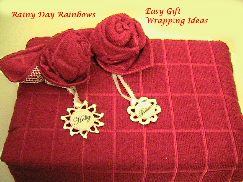 two dishcloth flowers and tags